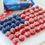 red white and blue Oreo truffles arranged on white plate