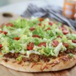 taco pizza on cutting board