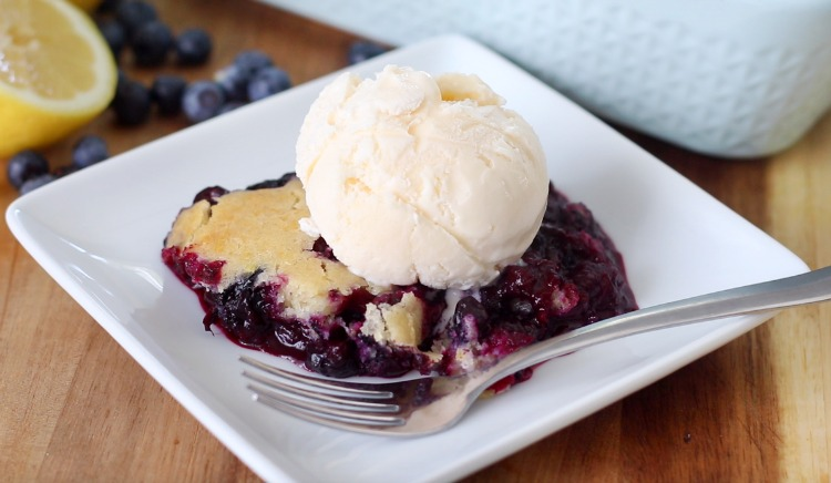serving of cobbler with ice cream on white plate