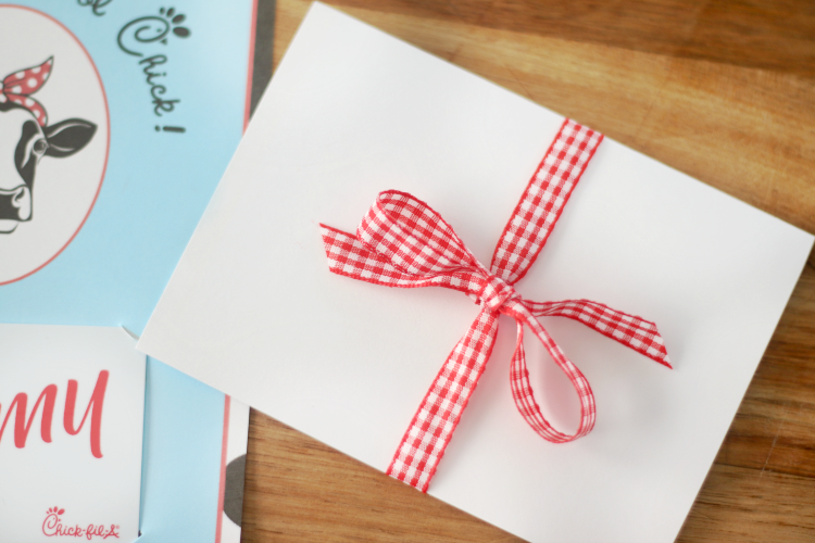 folded gift card holder tied with red checked ribbon