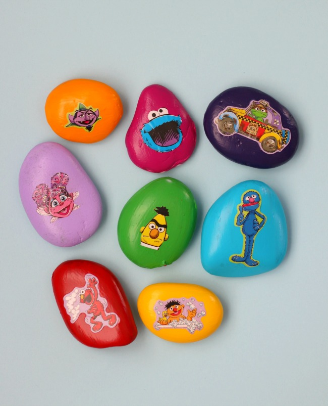 painted rocks with sesame street stickers on them