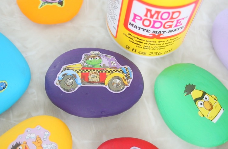 rocks painted with acrylic paint and sesame street stickers added