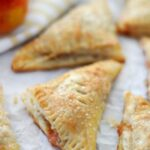 baked turnovers on parchment paper