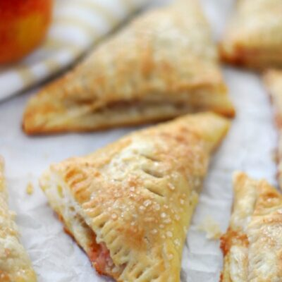 baked peach turnovers on baking sheet