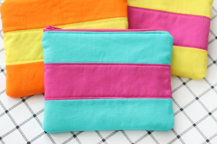 turquoise and pink striped costmetic bag