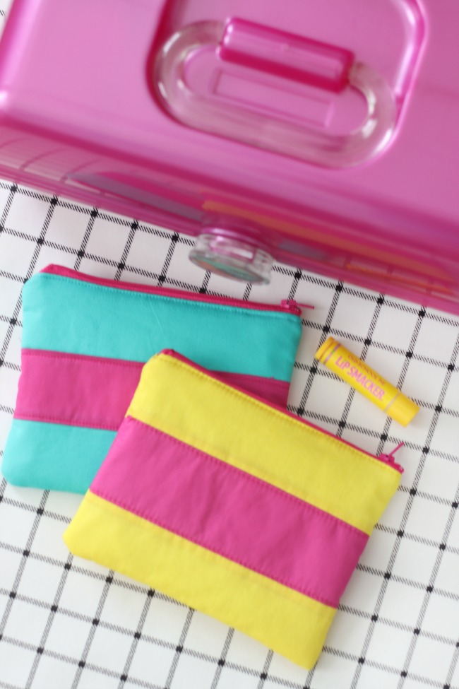 two cosmetic bags next to make up organizer