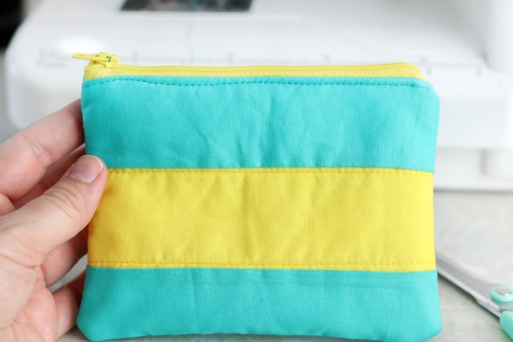 hand holding finished color blocked cosmetic bag
