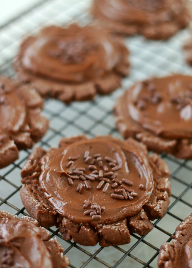 frosted chocolate sugar cookie on cooling rack
