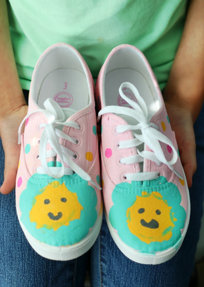pair of pink painted shoes with flowers