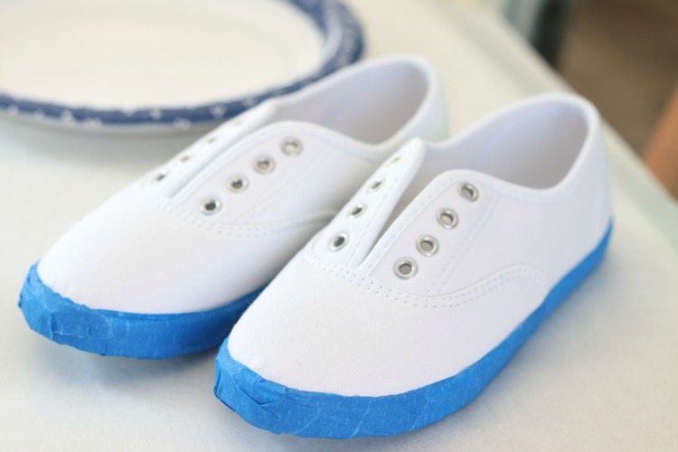 white canvas shoes wrapped with painter's tape