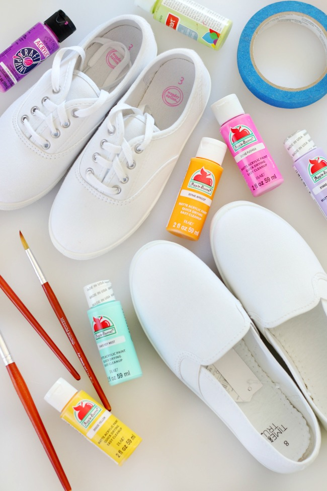 paint with paint brushes and white canvas shoes