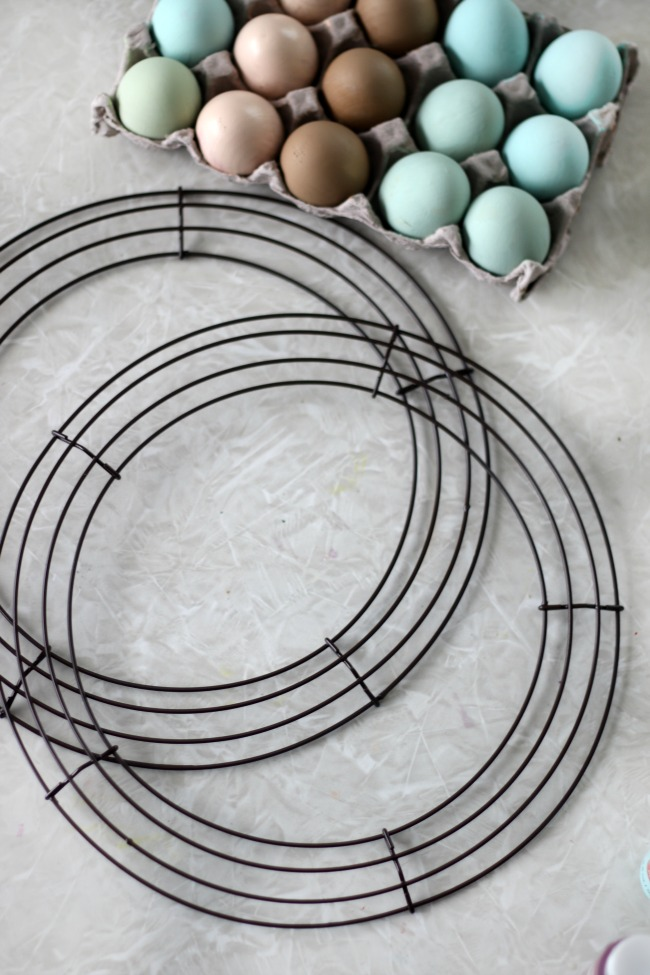 two wire wreath frames spray painted brown