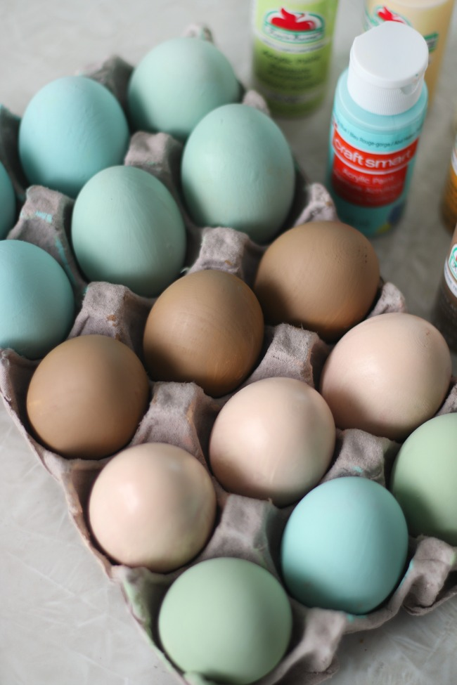 one dozen painted wooden eggs
