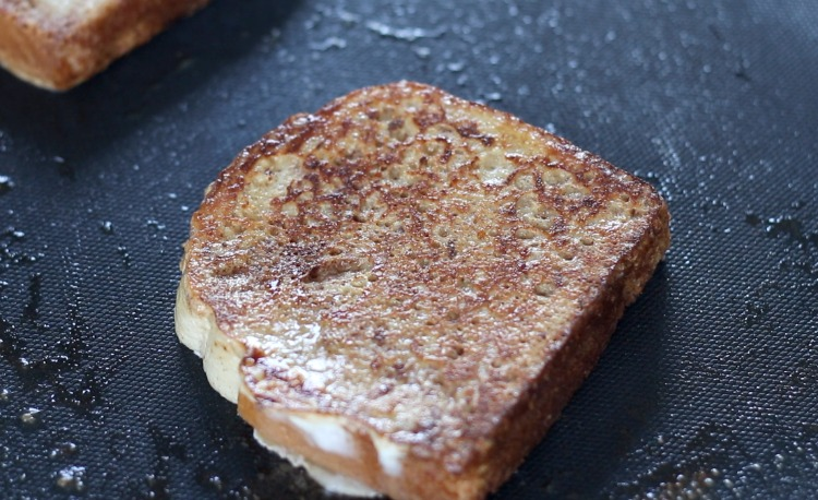 slice of french toast on griddle