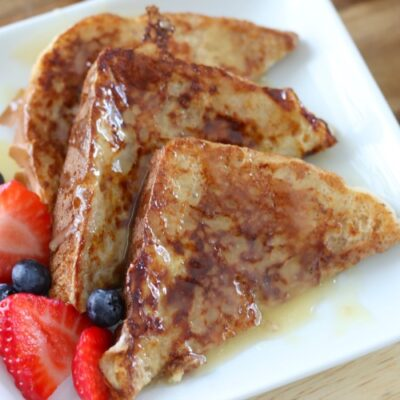 french toast drizzled in caramel syrup with fresh fruit