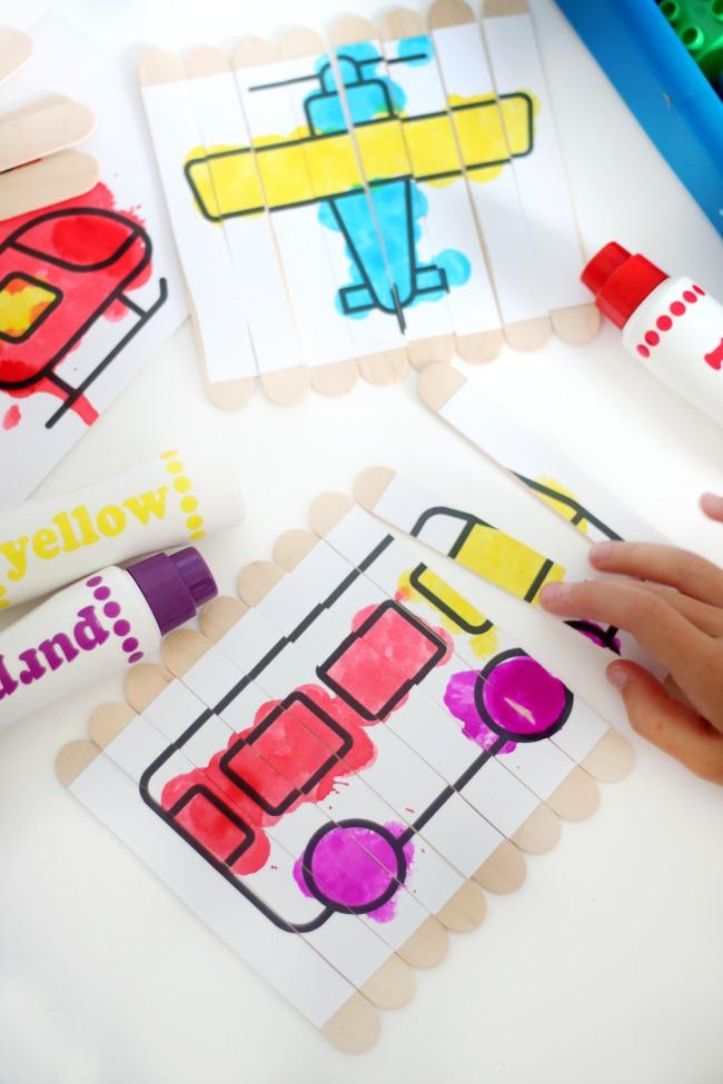 child putting puzzle sticks together