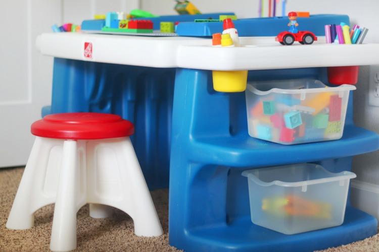 small preschool desk with legos in totes