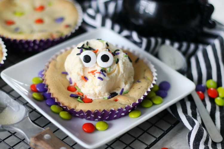 deep dish cookie with scoop of vanilla ice cream and candy eyes