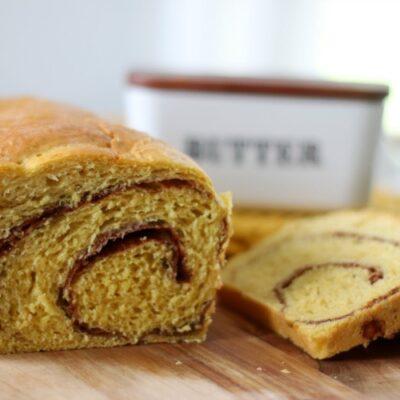 loaf of pumpkin cinnamon swirl bread sliced into