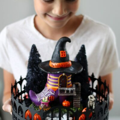 child holding halloween fairy garden