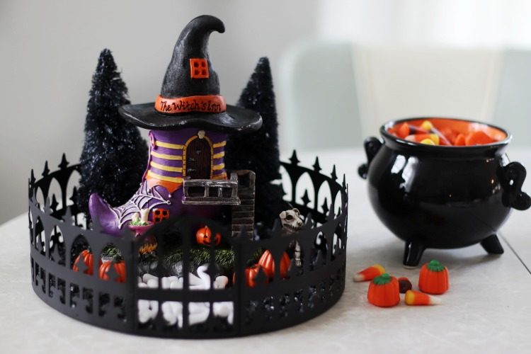 tabletop halloween centerpiece next to halloween candy bowl