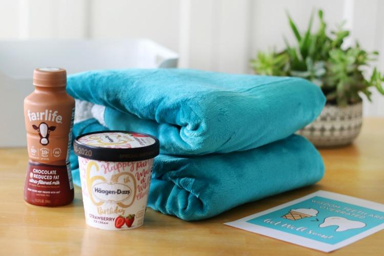 folded blanket and carton of ice cream