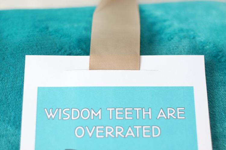 ribbon slid through slit of wisdom teeth card