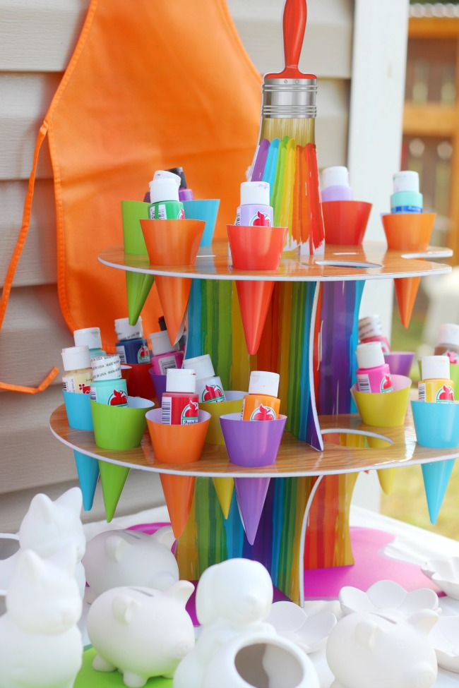 display with bottles of acrylic paint for pottery party