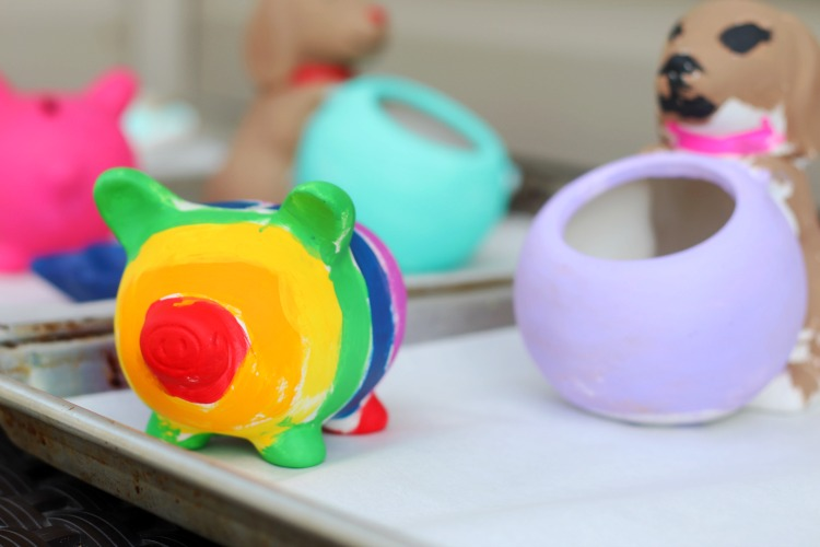 piggy bank painted with rainbow colors