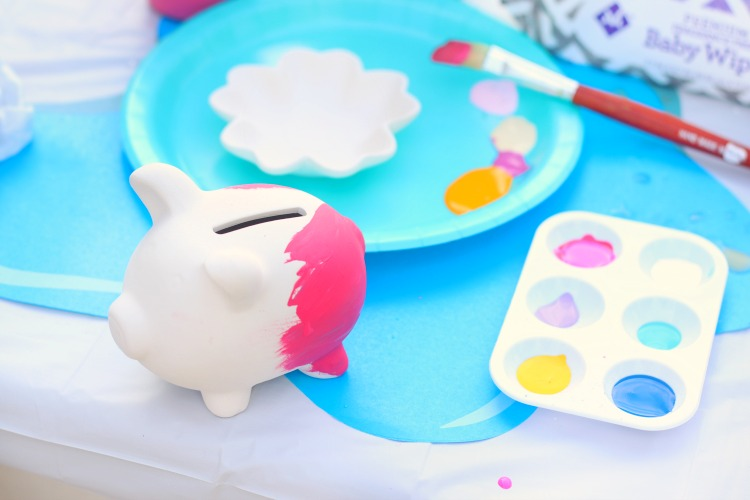 pink piggy bank and paint palette