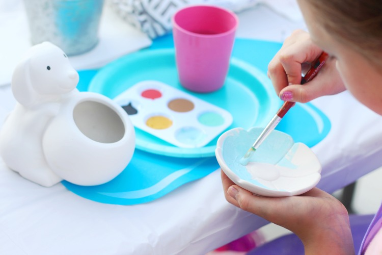 child painting ring dish at pottery party