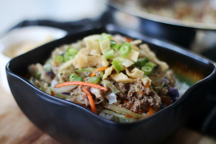 egg roll bowl with fried wonton strips and green onions