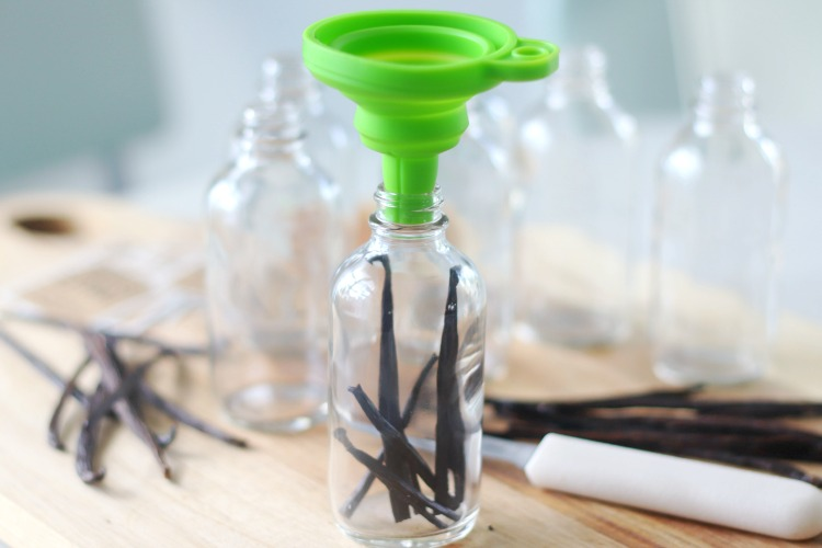 small funnel in bottle opening