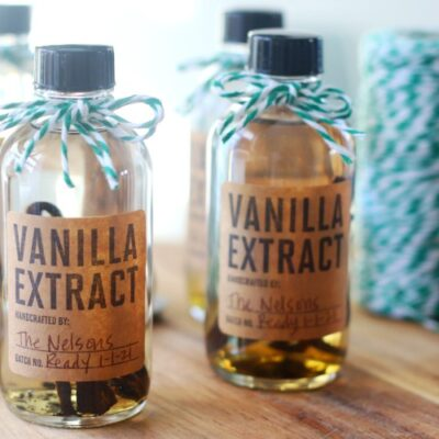 bottles of vanilla extract with green bakers twine