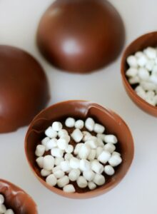 open hot chocolate bomb with cocoa and marshmallows inside