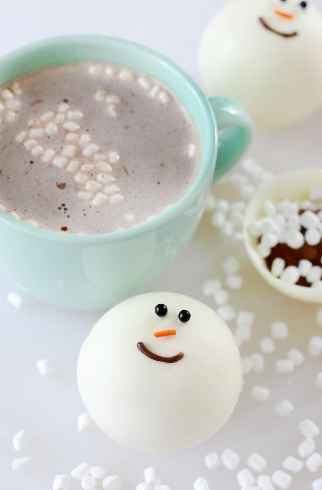 hot chocolate bomb near mug of hot chocolate