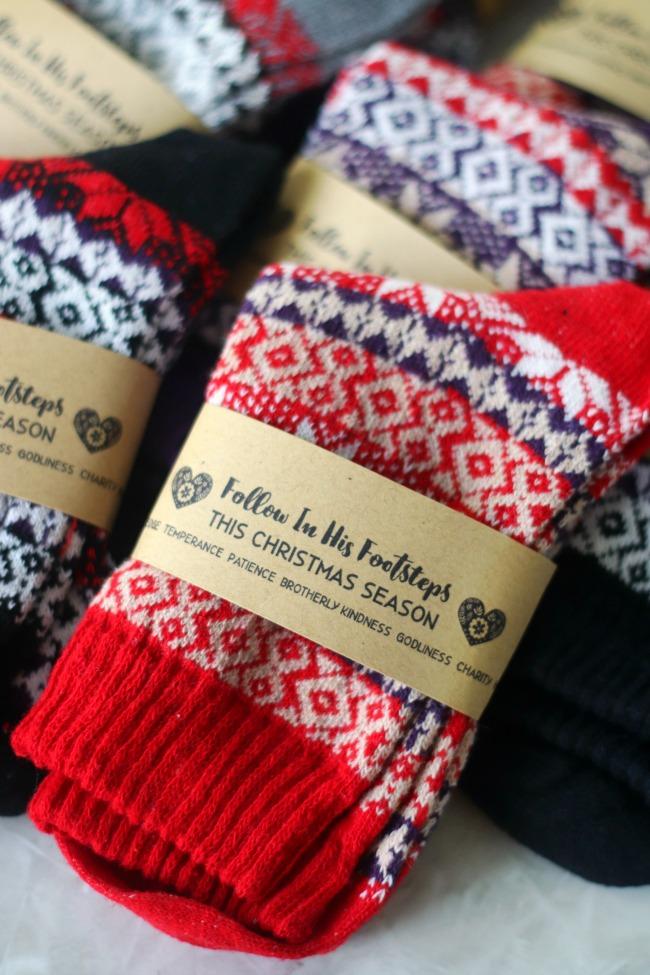 stack of christmas socks with printable tags wrapped around