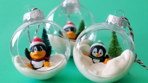 3 penguin ornaments on green backdrop