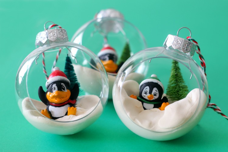 3 penguin ornaments on green backdrop