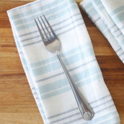 cloth napkin folded with fork on top