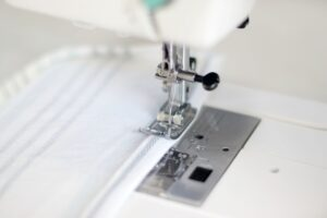 sewing machine showing how to sew cloth napkin edge