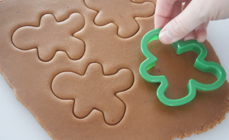 quick gingerbread cookie dough rolled out and cut out with cookie cutters