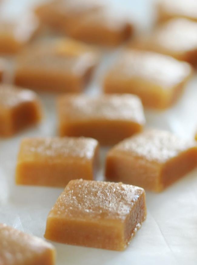 sliced caramel squares on parchment paper