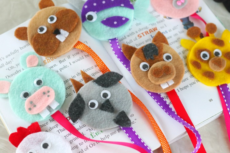 animal bookmarks lined up on book
