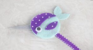 narwhal bookmark on table