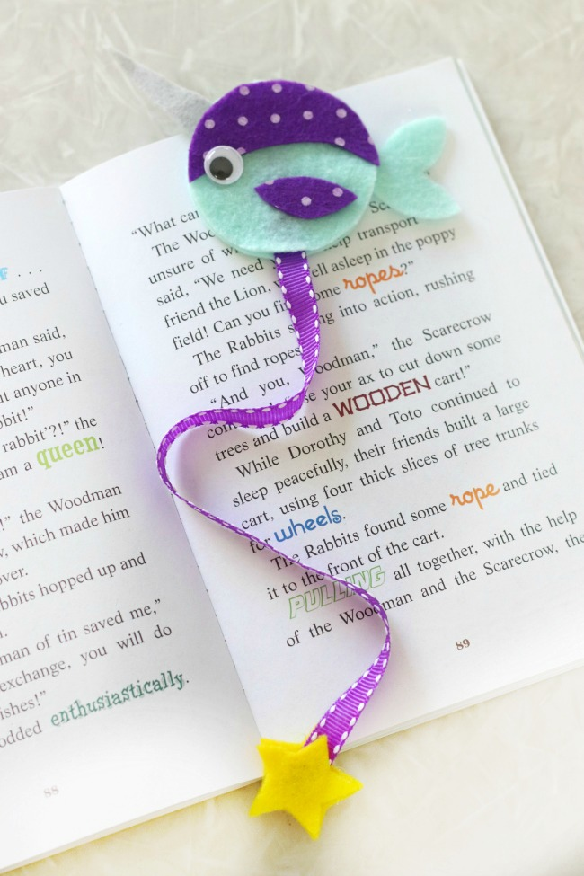 narwhal bookmark in book