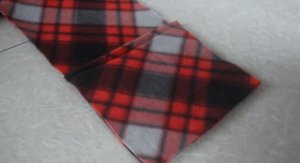 pocket placed over end of scarf fabric