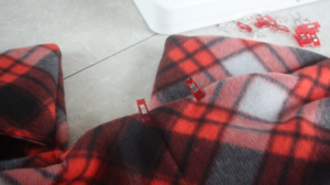 edge of scarf closed with sewing clips