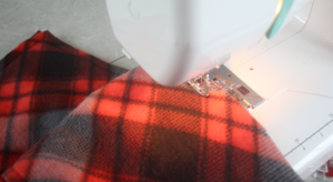 fleece being sewn by sewing machine