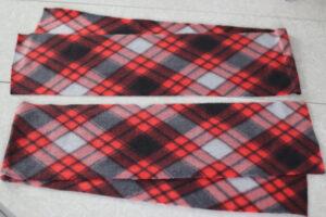 two strips of fleece cut into long rectangles